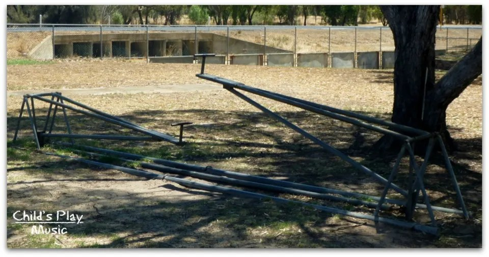 Hinged see-saw where the riders sit facing each other at the centre, at Katanning All Ages Playground