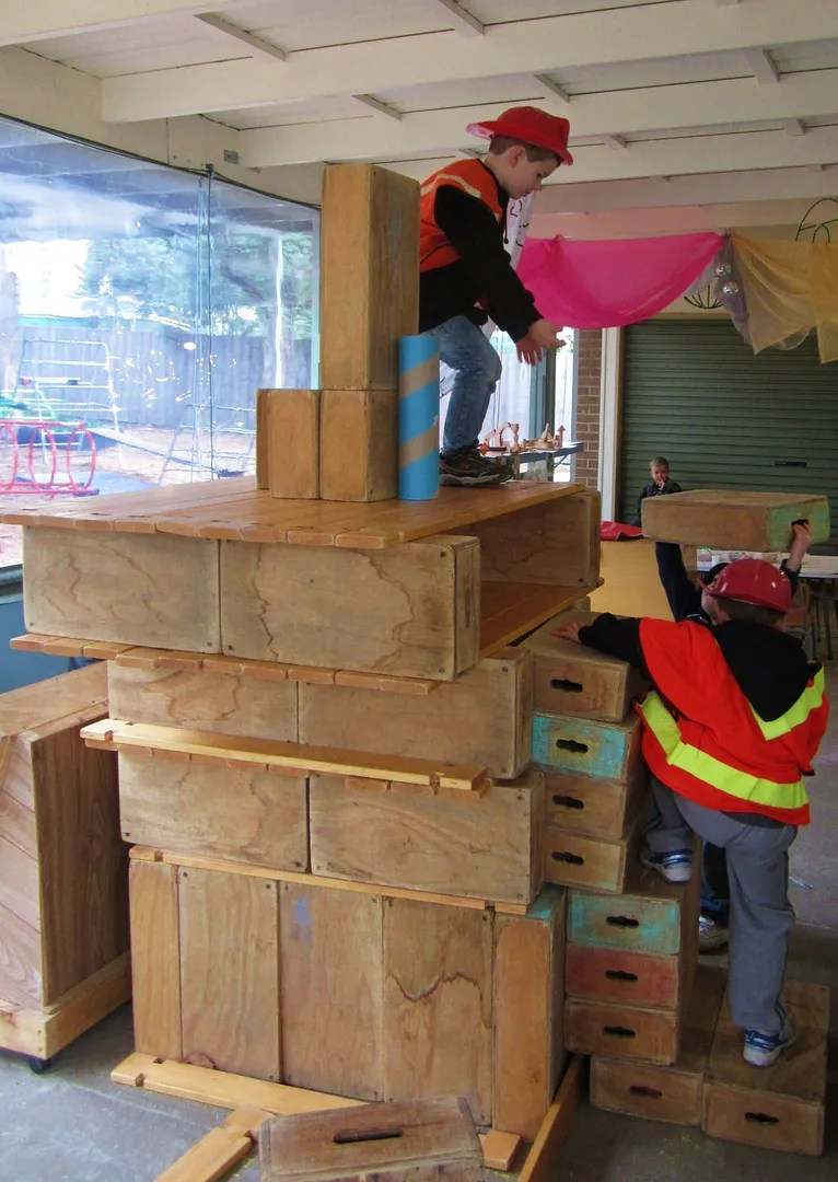 Children Building Huge Block Tower