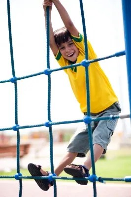 Image of a child climbing a net