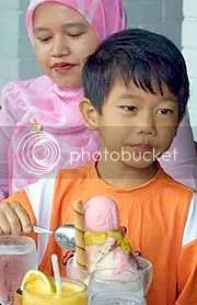 Adi Putra enjoying an ice-cream