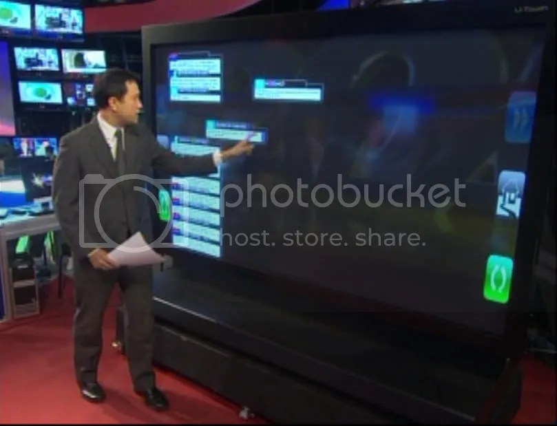 TJ Manotoc reviews tweets using Halalan 2010's 103 inch touchscreen