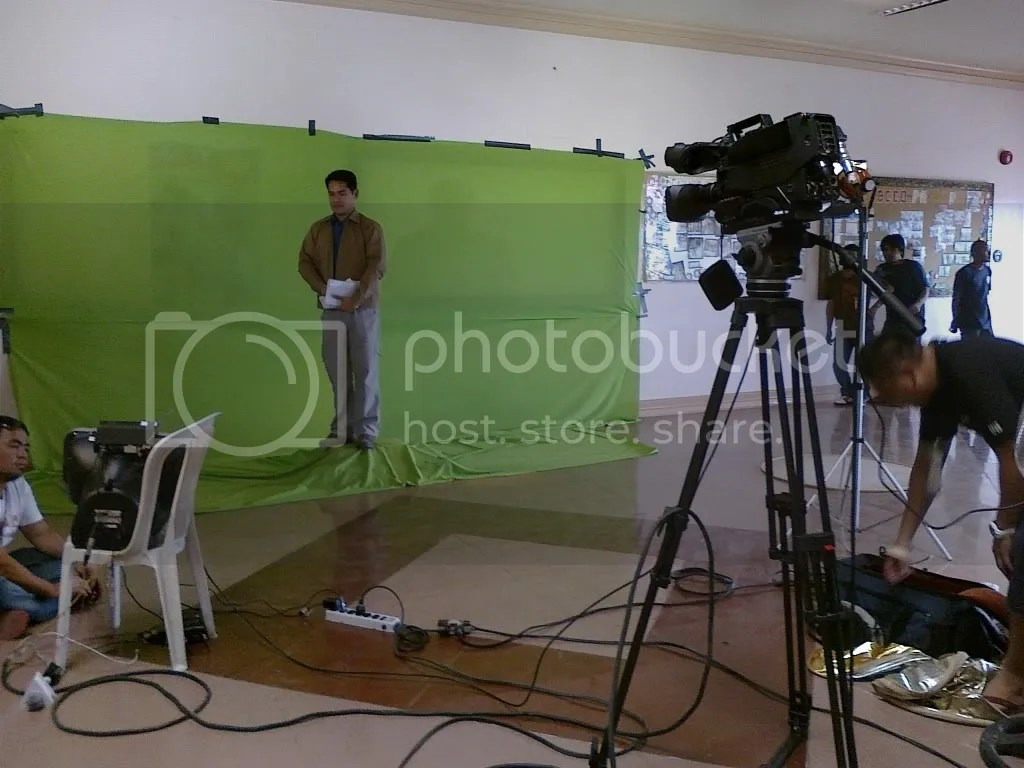 Jiggy Manicad in front of green screen in Maguindanao