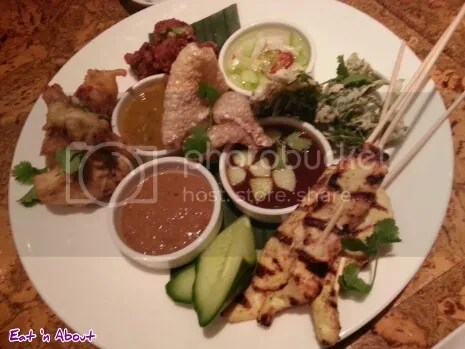 satay gai, pork rinds, tempura fern, nahm jim, and crispy fried oysters at Maenam