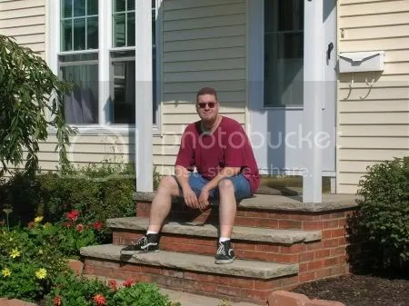 Me sitting on the front porch of my house right after getting the keys.