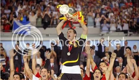 Goalie Iker Casillas raises the trophy