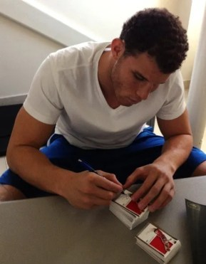 Blake Griffin Signing Autographs On 2011-12 Panini Preferred Basketball Cards