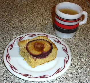 Piece of Dimply Plum Cake with Tea