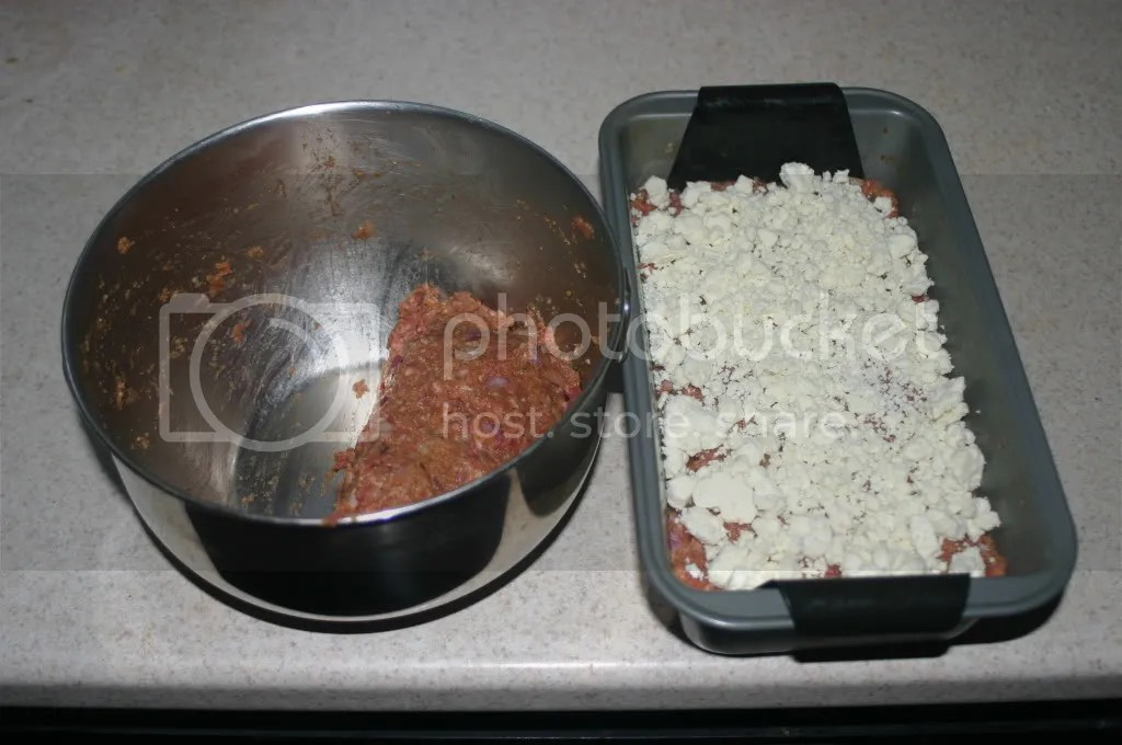 Half the Meatloaf in the pan with the Feta Cheese Layer