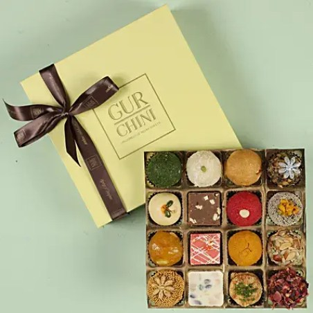 assorted exotic mithai in pastel green box 16 pcs 1