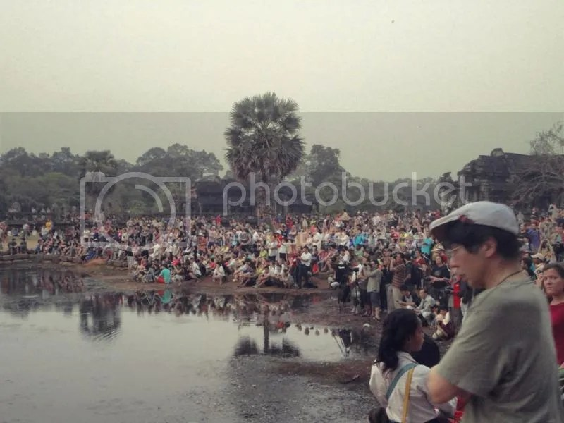 Sharing your sunrise with hundred other tourists in Angkor Wat, Siem Reap, Cambodia