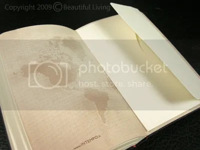 An envelope in the rear of the planner has a flap that folds over to keep imtes inside.