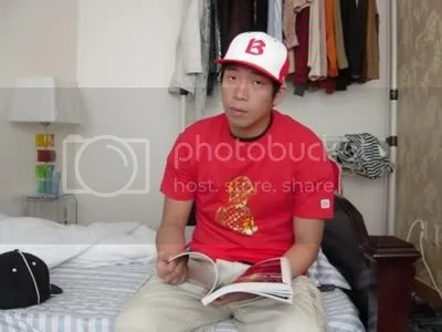 MC Mong wearing Tshirt and hat