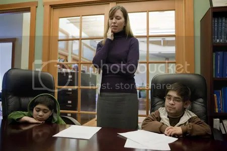 Tribune Photo: Christopher Onstott • Portland attorney Nicole Nelson is working free of charge in an effort to keep Hanzallah (left) and Aamir Khandwalla and their family from being sent back to Kenya. The family has until April 1 to leave the U.S.