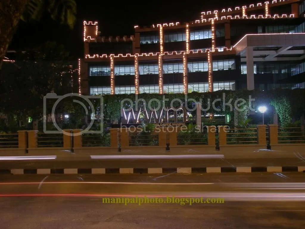 Photograph of the Manipal University Health Sciences library lit up for convocation