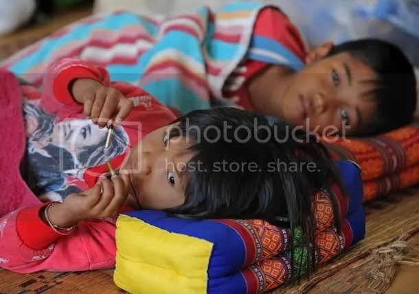 Thai children rest after being evacuated from their homes