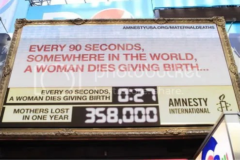 Amnesty International maternal mortality clock billboard, New York, US