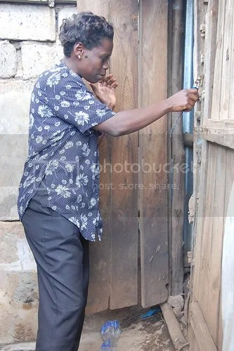 Woman at shared toilet - Kibera slum, Nairobi, Kenya