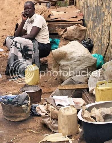 Woman on the street of Kibera slum trying to sell her belongings. Image: Chrissy Olsen