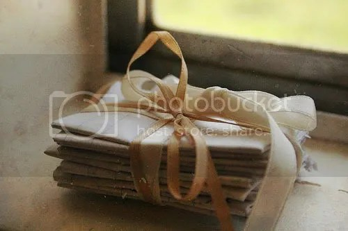 old letters bundled together on the window sill