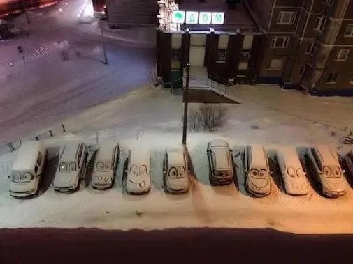snowy cars with faces