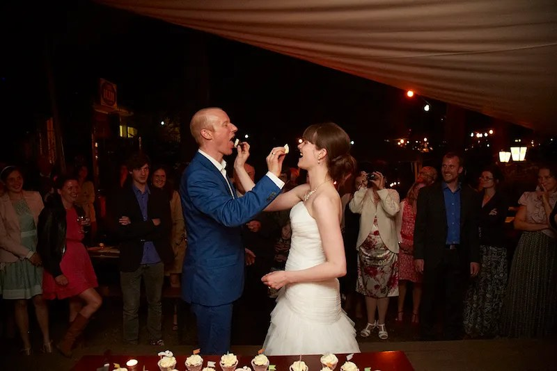 feeding each other the wedding cake