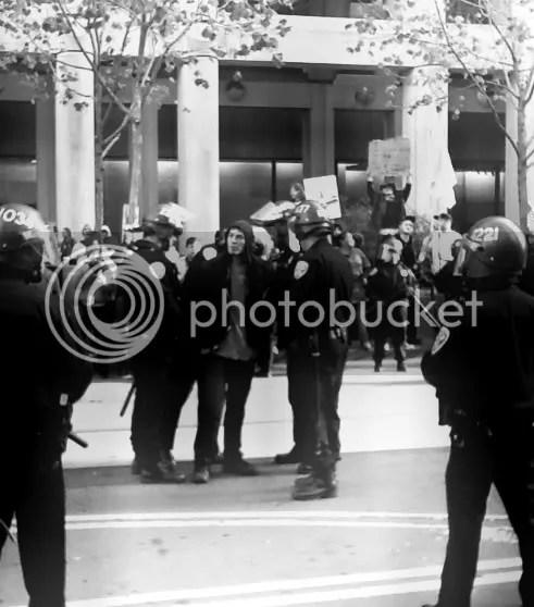 One Arrest, Two dozen San Francisco cops arrest one non-violent OccupySF protester Dec. 7, 2011 on Market St.