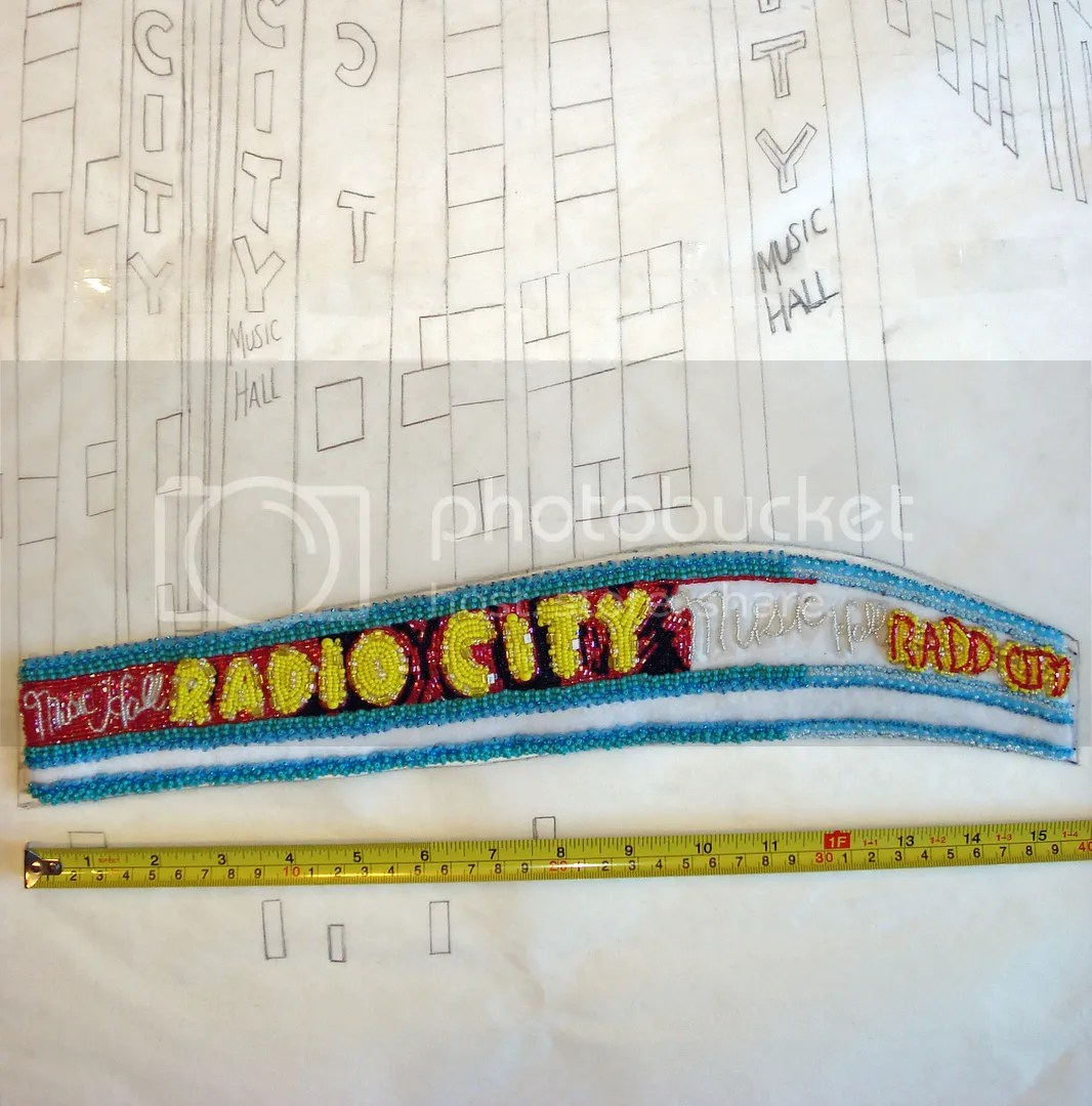 beaded Radio City Music Hall painting mixed media bead embroidery beadwork NYC taxi cab scene