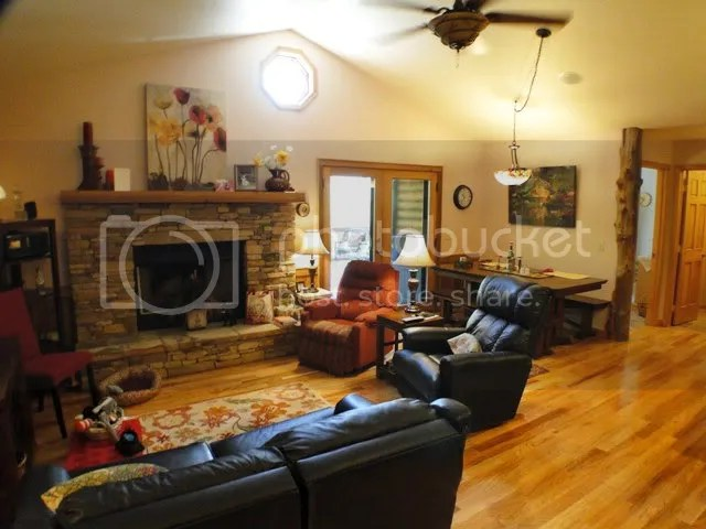 Rich hardwood floors, vaulted ceiling and fireplace in the cheerful living room, Franklin NC Homes for Sale, Franklin NC Log Home
