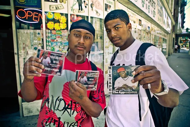 Rappers hustling music in the streets
