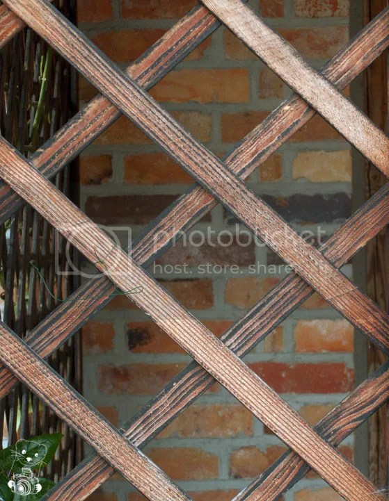 Wooden structure against a red brick wall at the Krabatmühle in Saxony, Germnany