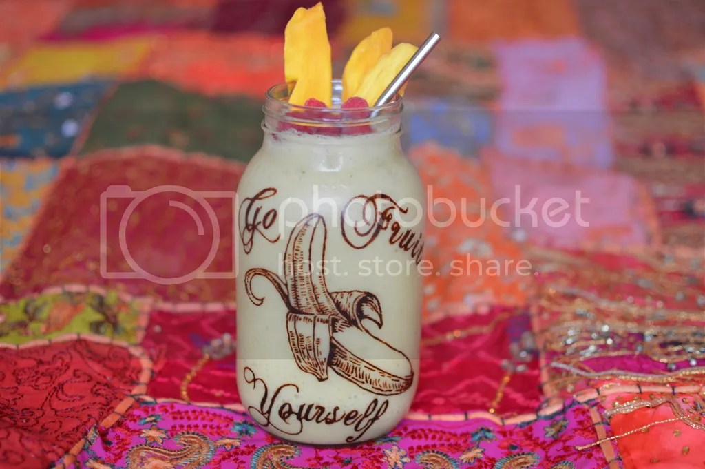 Mango and banana smoothie. The banana is painted in raw chocolate