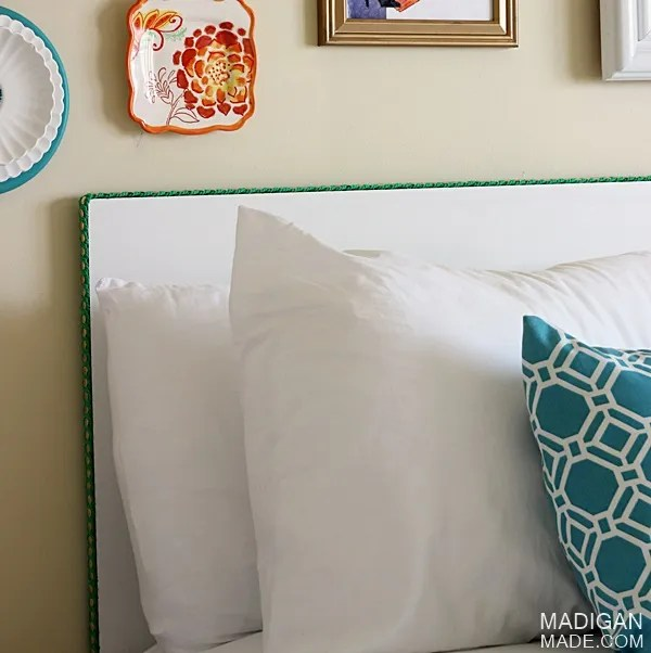 bright and colorful guest room decor with a simple DIY headboard