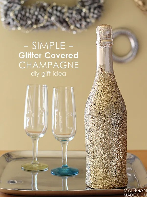 """Simple glitter covered champagne bottle - what a fun and easy way to """"wrap"""" a bottle for a hostess gift."""