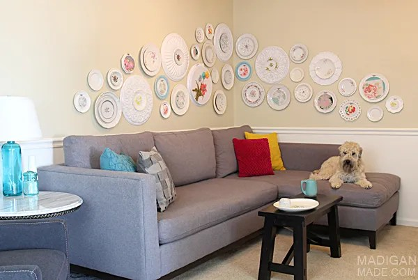 Simple and lovely DIY gallery wall art using vintage plates, fabric and ceiling medallions. Love this!