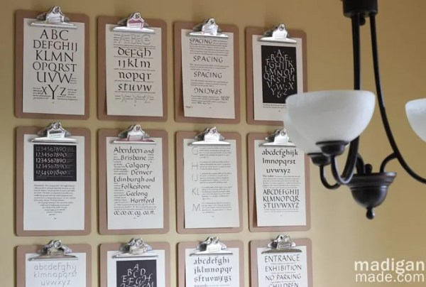 clipboard wall with calligraphy book pages