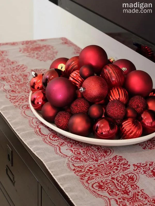 elegant and big bowl of red ornaments - part of the holiday home tour at madiganmade.com