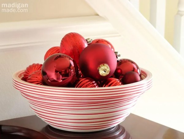 container of red ornaments - part of the holiday home tour at madiganmade.com