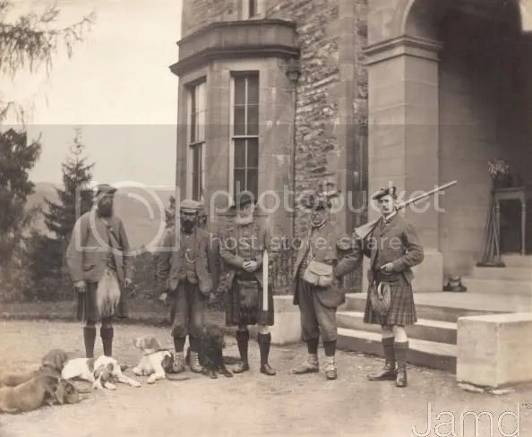Scottish hunters and their dogs preparing for a deer hunt.   Taken in Perthshire, Scotland, 1869.