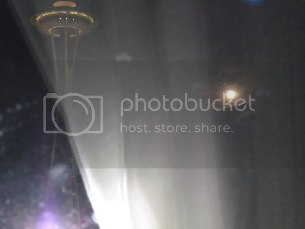 space needle and full moon