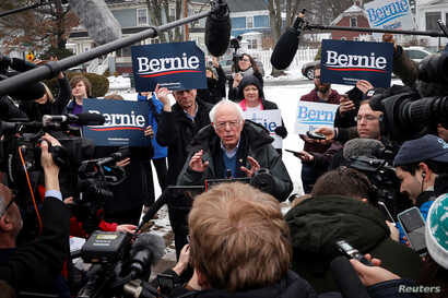 Democratic U.S. presidential candidate Senator Bernie Sanders speaks to the media at a polling station at the McDonough School…