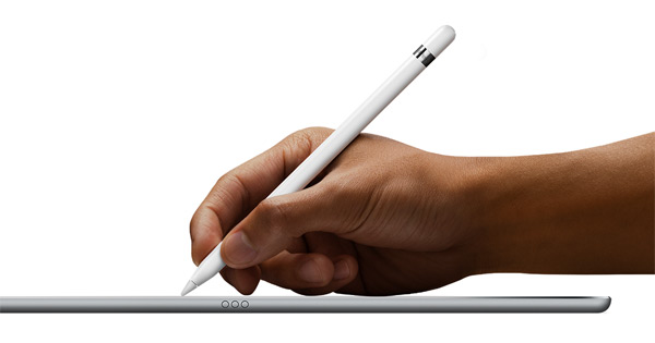 Image of Apple Pencil being used with iPad Pro on flat surface