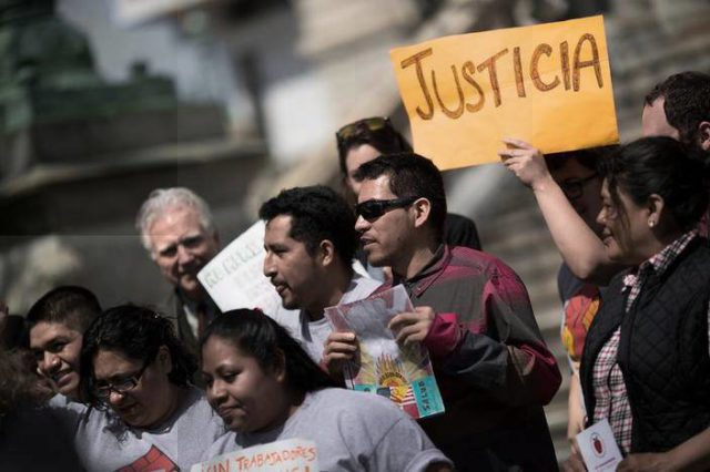 Crispin Hernandez (far left), Rebecca Fuentes and members of the Workers Center of Central New York announce historic suit for farmworker rights, May 10