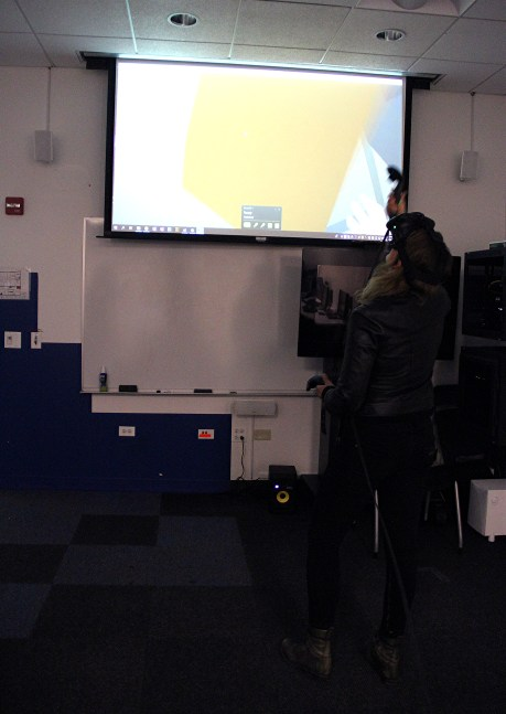 Guest playing a VR game at IAM's open house