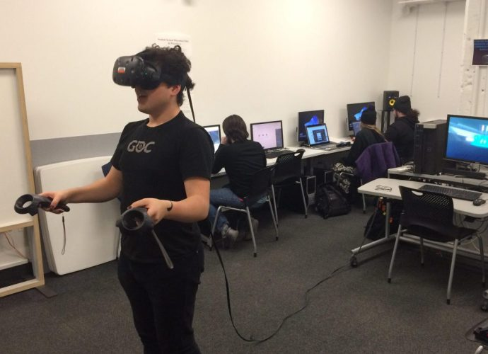 Student Parker Hamilton playing the game M.M.O. VR (senior capstone project 2019)
