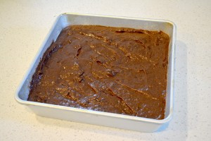 brownie batter in square pan