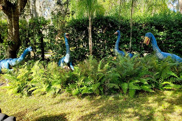 four blue dinosaurs eat ferns