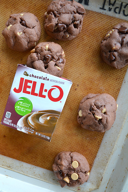 Overhead view of chocolate cookies on baking mat with jello-o box in front