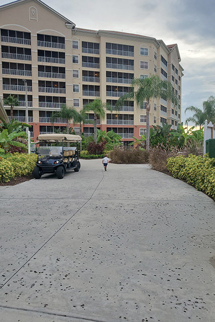 little boy on a walk way at Westgate Town Center Resort