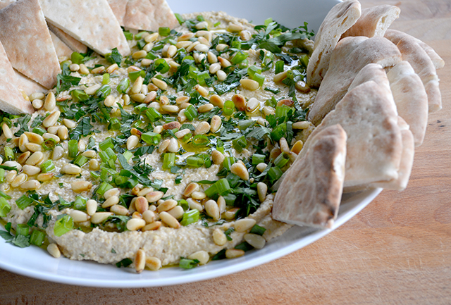 Homemade Hummus Toasted Pine Nuts generously sprinkled with pine nuts, green onion, and olive oil
