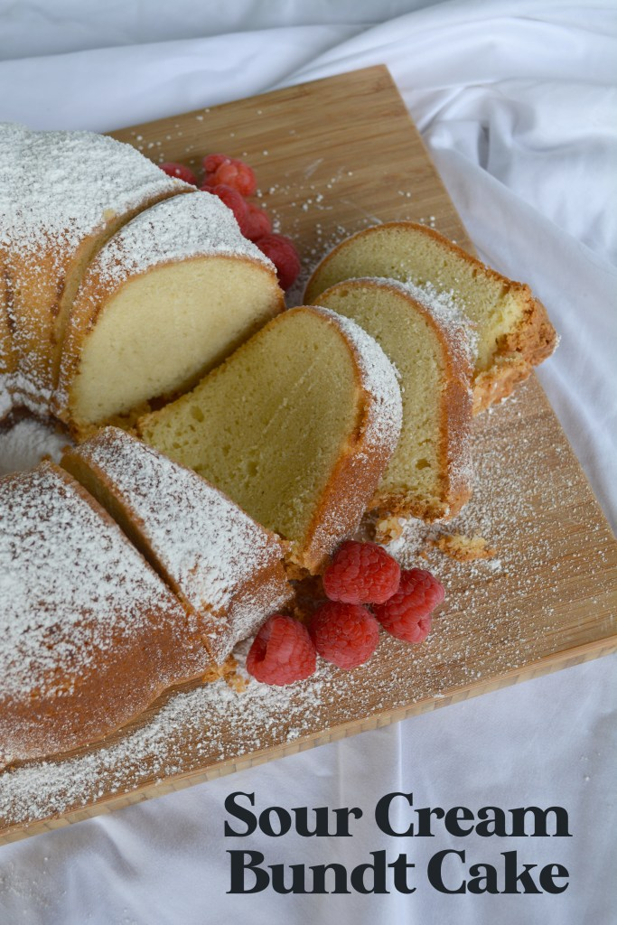 sliced sour cream pound bundt cake fanned out on a cutting board